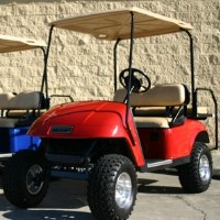 EZ-GO Lifted Red 36 Volt Electric Golf Cart